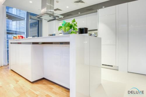A kitchen or kitchenette at Two Bedroom Apartment with Balcony in BlueWaters Residence 7 by Deluxe Holiday Homes