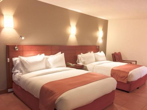Кровать или кровати в номере Holiday Inn & Suites Port Moresby