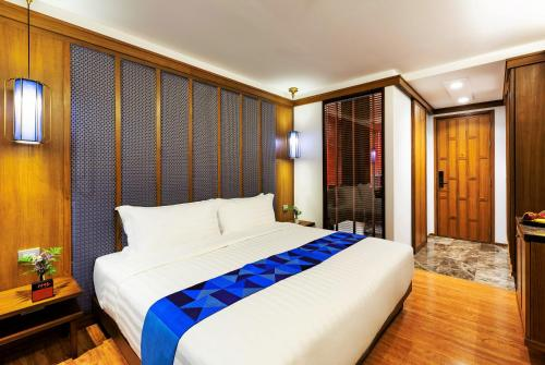 A bed or beds in a room at Lavana Hotel Chiangmai