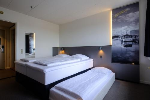 A bed or beds in a room at Zleep Hotel Ishøj