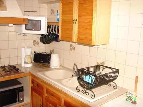 A kitchen or kitchenette at Location Vanoise