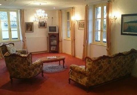 A seating area at L'Hostellerie des Lacs