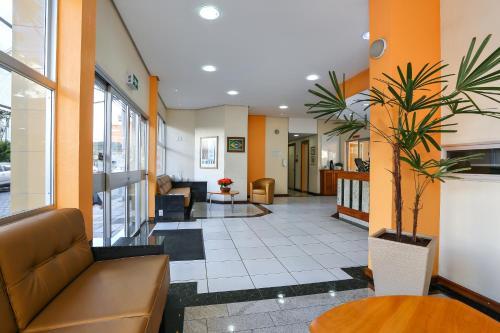 The lobby or reception area at Hotel Express São Leopoldo