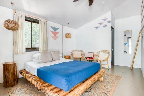 A bed or beds in a room at Selina Tamarindo