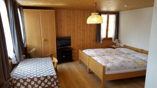 Ein Bett oder Betten in einem Zimmer der Unterkunft Gasthof Rössli Gondiswil