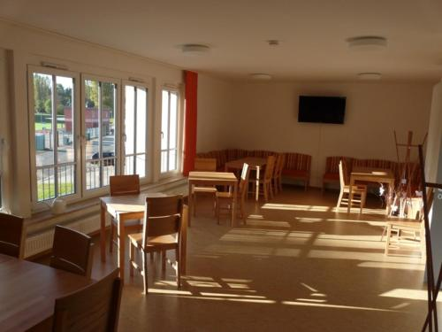 A restaurant or other place to eat at Sport Tourist Hostel Weißenfels
