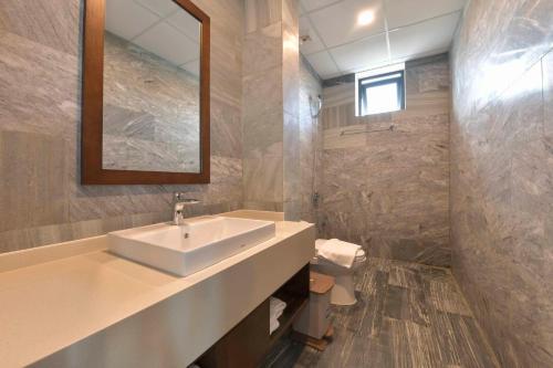 A bathroom at Cocoland River Beach Resort & Spa