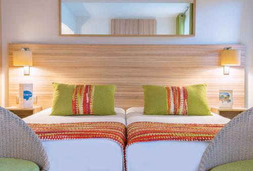 オテル ヴァカンス ブル デルクロワにあるベッド