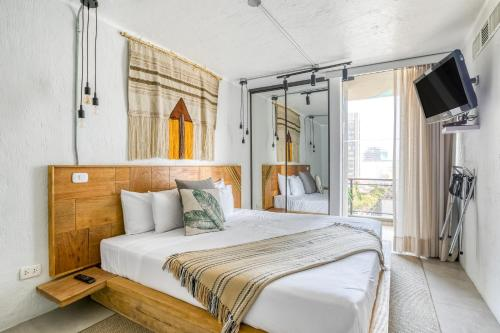 A bed or beds in a room at Selina Apartments Miraflores