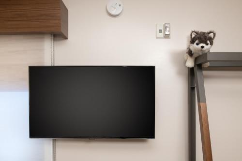 Una televisión o centro de entretenimiento en Staypineapple, Hotel Z, Gaslamp San Diego