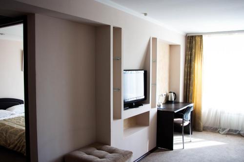 Телевизор и/или развлекательный центр в Гостиница Орбита