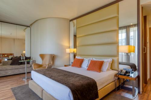 Cama ou camas em um quarto em TURIM Av. Liberdade Hotel