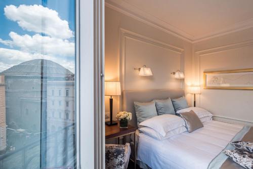 Un ou plusieurs lits dans un hébergement de l'établissement Grand Hotel De La Minerve