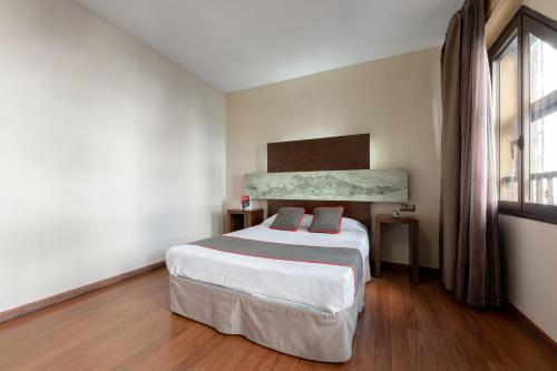 A bed or beds in a room at OYO Hotel Francabel
