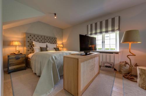 Ein Bett oder Betten in einem Zimmer der Unterkunft Weissenhaus Grand Village