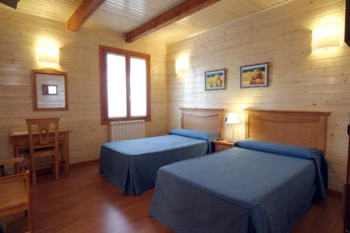 A bed or beds in a room at Complejo La Cabaña