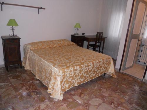 A bed or beds in a room at Soggiorno Migliorini