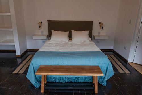 Una cama o camas en una habitación de Complejo Odella Casas de Montaña