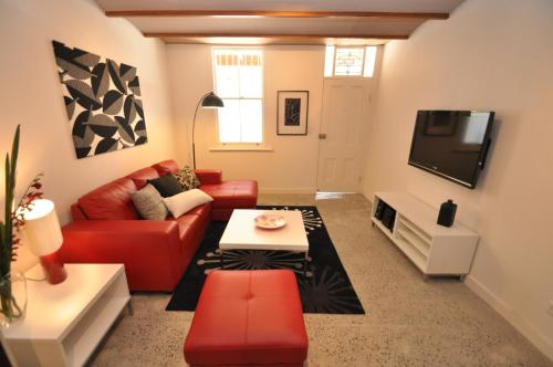 A seating area at Camperdown Self-Contained Modern Two-Bedroom Apartment (21 BRIGS)