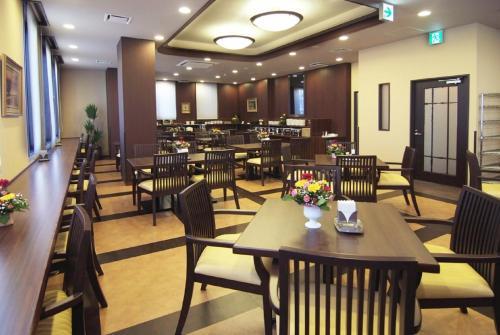 Restaurant ou autre lieu de restauration dans l'établissement Hotel Route-Inn Toki