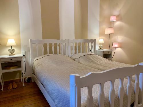 Un ou plusieurs lits dans un hébergement de l'établissement le carré des arts