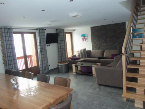 A seating area at Chalet Prestige Beausoleil - Vue Panoramique