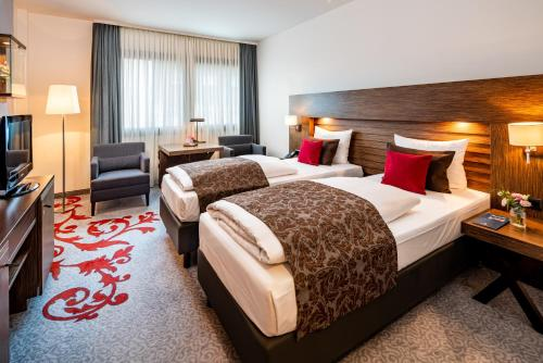 A bed or beds in a room at Park Plaza Trier