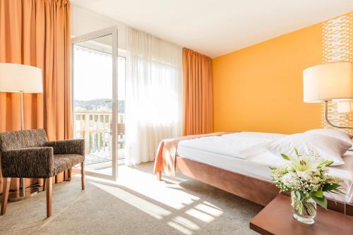 Ein Bett oder Betten in einem Zimmer der Unterkunft Aldiana Club Salzkammergut und GrimmingTherme