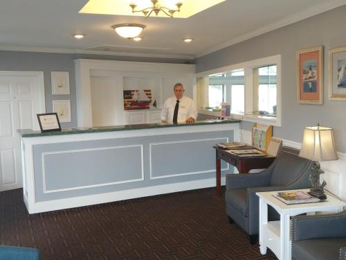 The lobby or reception area at Hyannis Travel Inn