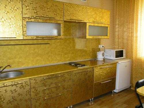 A kitchen or kitchenette at Apartments on Buinskiy 1