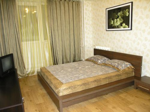 A bed or beds in a room at Apartments on Otradnaya and Kho Shi Mina