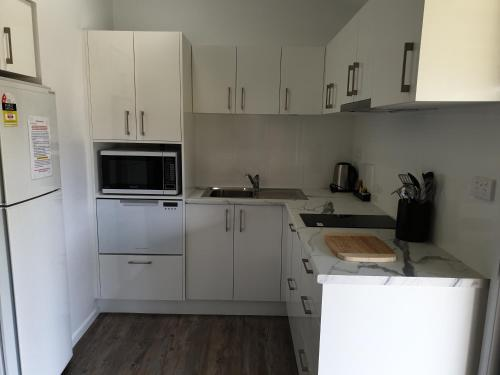 A kitchen or kitchenette at Tuncurry Lakes Resort