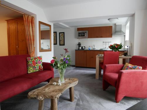 Een zitgedeelte bij Appartementen de Strandloper