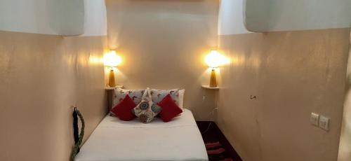 Un ou plusieurs lits dans un hébergement de l'établissement Riad Dar Mchicha