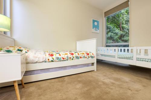 A bed or beds in a room at Seascape - The Ultimate Inverloch Retreat
