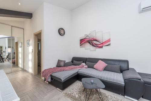 A seating area at Apartments Luky