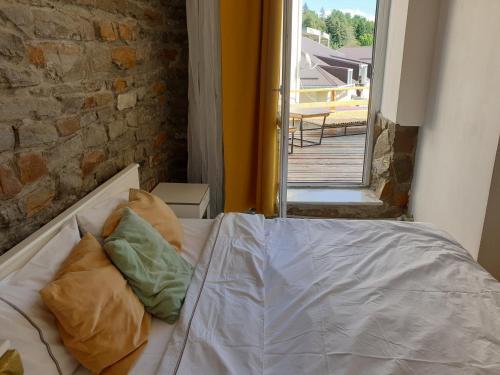 Кровать или кровати в номере Апарт-Отель Депутатский