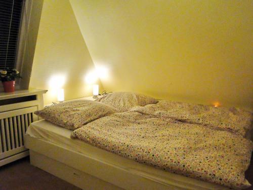 Ein Bett oder Betten in einem Zimmer der Unterkunft Sylter Rabe