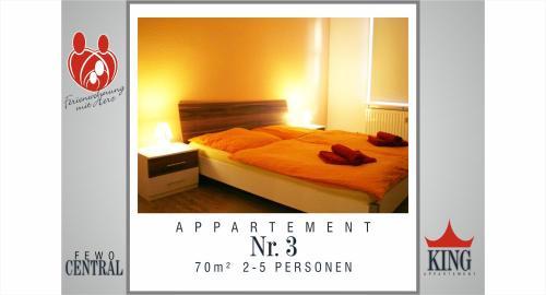 Ein Bett oder Betten in einem Zimmer der Unterkunft Wimaria Apartments - Central