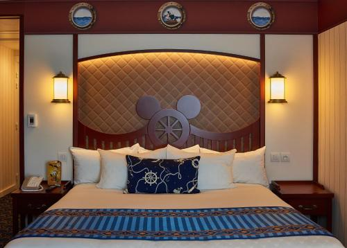 A bed or beds in a room at Disney's Newport Bay Club®