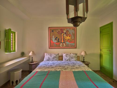 A bed or beds in a room at Riad Volubilis