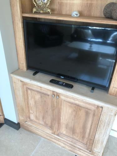 A television and/or entertainment centre at Villa Belle dune