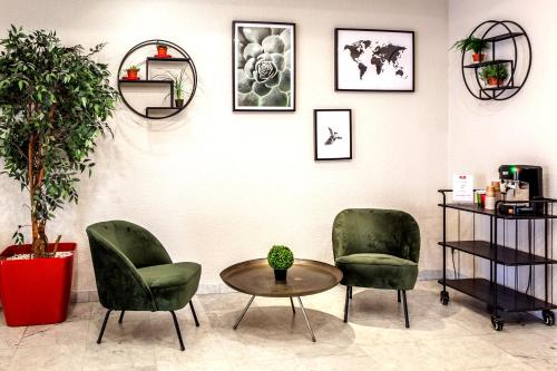 Coin salon dans l'établissement Appart'City Genève – Gaillard