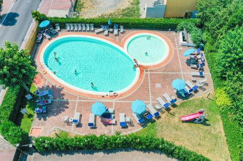 A view of the pool at Hotel Riel or nearby