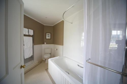 A bathroom at The Creggans Inn