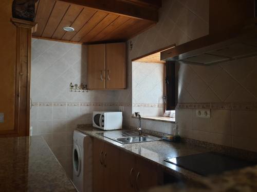 A kitchen or kitchenette at La Casina de Terobe