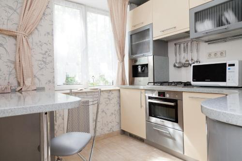 Кухня или мини-кухня в Апартаменты Савеловская President