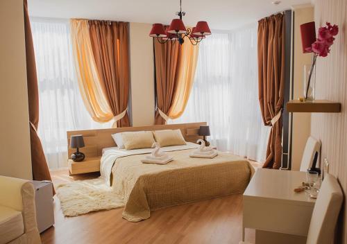 Кровать или кровати в номере Отель Апельсин