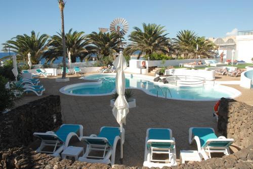 Het zwembad bij of vlak bij Neptuno Suites - Adults Only