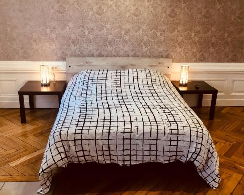 A bed or beds in a room at D: Centre ville de Lyon